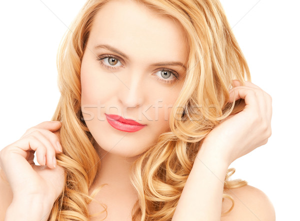 Stock photo: beautiful woman playing with long hair