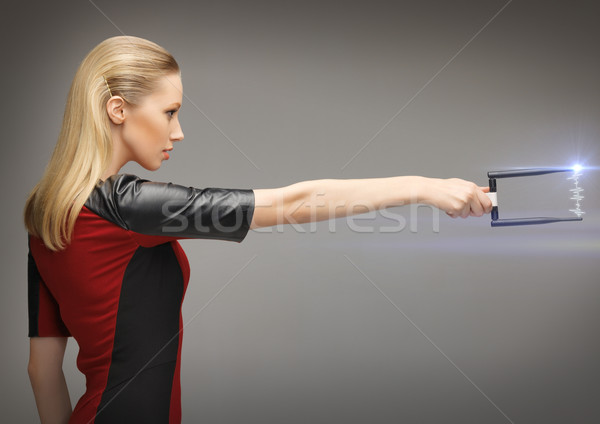 woman with sci fi weapon Stock photo © dolgachov