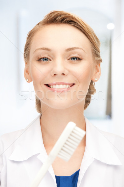 attractive female doctor with toothbrush Stock photo © dolgachov