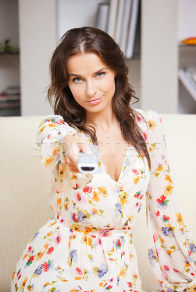 woman with TV remote Stock photo © dolgachov