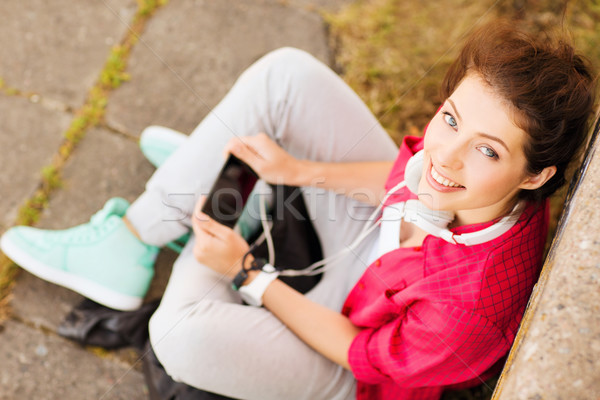 Stock photo: girl with headphones listening to music
