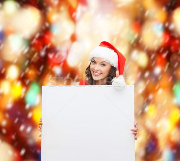 Nő mikulás segítő kalap fehér tábla karácsony Stock fotó © dolgachov