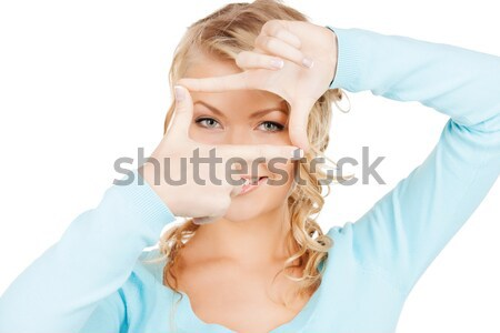 woman creating a frame with fingers or snapshot Stock photo © dolgachov