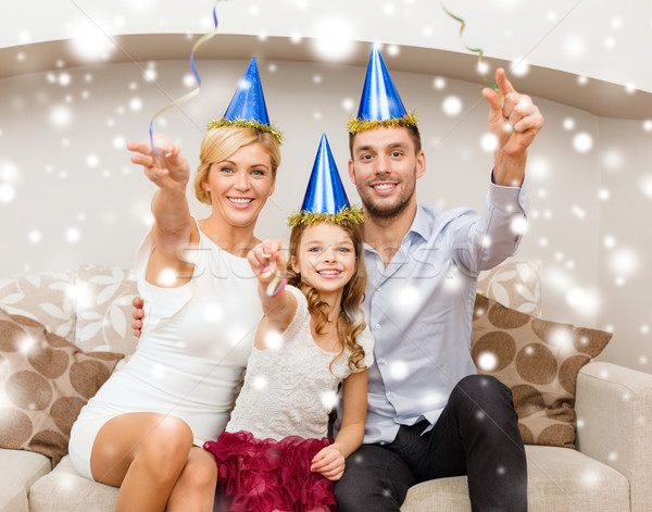 happy family in blue hats throwing serpentine Stock photo © dolgachov