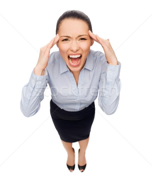 frightened businesswoman screaming Stock photo © dolgachov