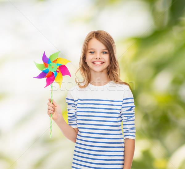 Uśmiechnięty dziecko kolorowy wiatrak zabawki edukacji Zdjęcia stock © dolgachov