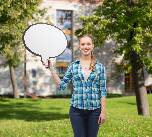 smiling young woman with blank text bubble Stock photo © dolgachov