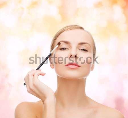 Bella donna mascara cosmetici salute bellezza nero Foto d'archivio © dolgachov