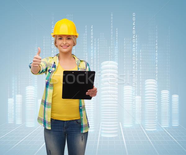 Sorrindo capacete clipboard reparar construção manutenção Foto stock © dolgachov