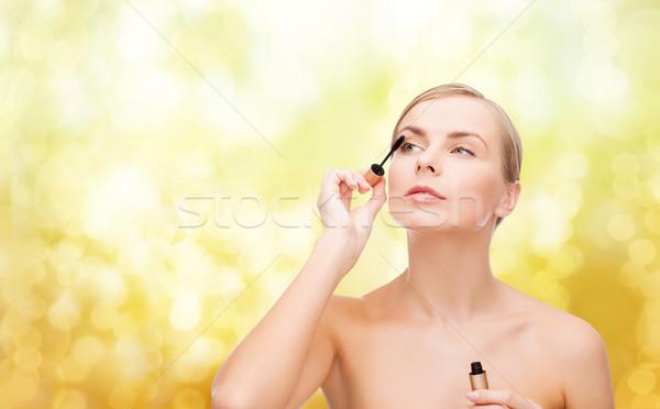 beautiful woman with mascara Stock photo © dolgachov