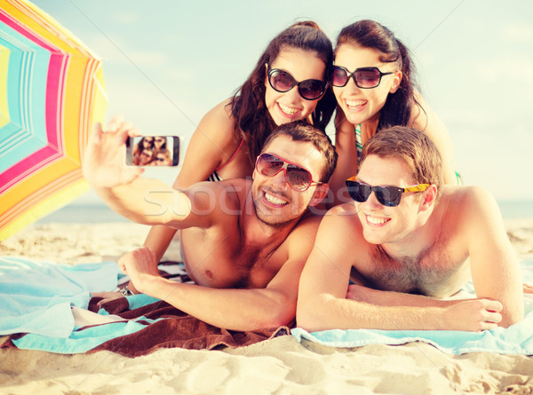group of people taking picture with smartphone Stock photo © dolgachov