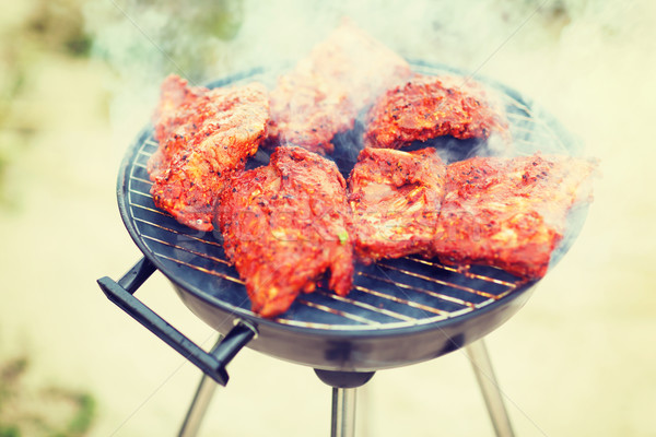 close up of meat on grill outdoors Stock photo © dolgachov