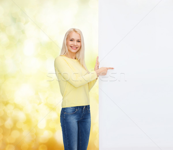 smiling woman in sweater with blank white board Stock photo © dolgachov