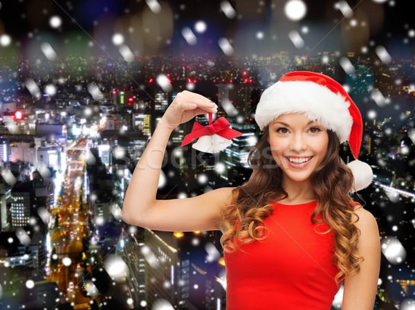 Uśmiechnięta kobieta Święty mikołaj pomocnik hat christmas wakacje Zdjęcia stock © dolgachov