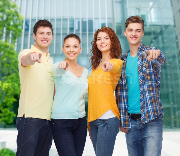 Csoport mosolyog tinédzserek mutat ujjak barátság Stock fotó © dolgachov