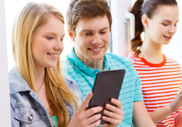 smiling students with tablet pc at school Stock photo © dolgachov