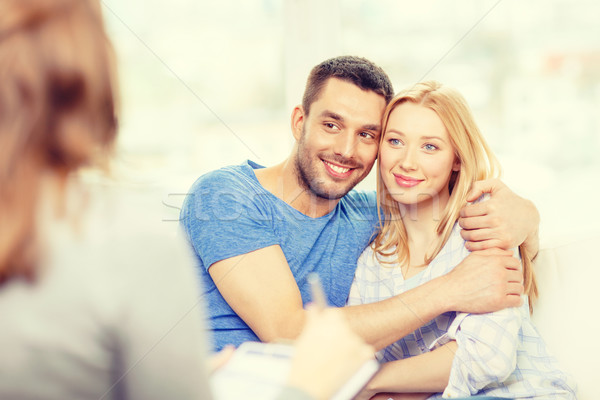 young couple hugging at psychologist office Stock photo © dolgachov