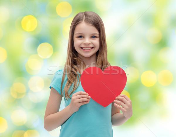 Gülen küçük kız kırmızı kalp sevmek hayır Stok fotoğraf © dolgachov