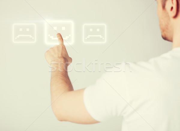 hand touching virtual screen with smile button Stock photo © dolgachov
