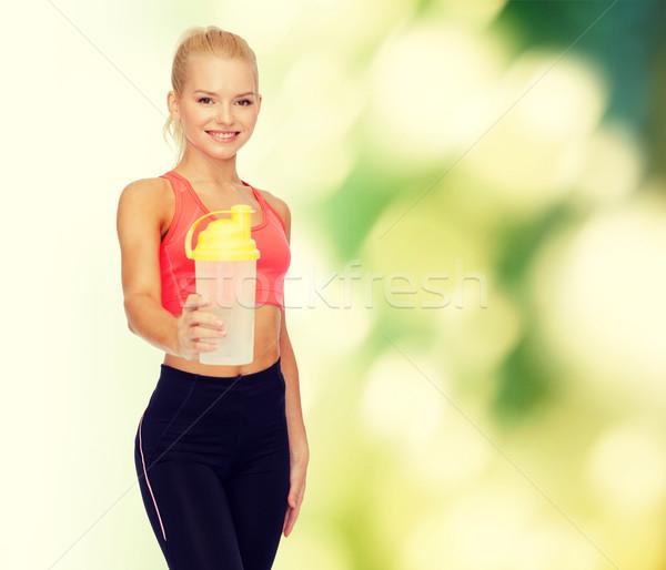 Sonriendo deportivo mujer proteína Shake botella Foto stock © dolgachov