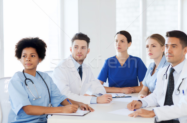 group of happy doctors on conference at hospital Stock photo © dolgachov