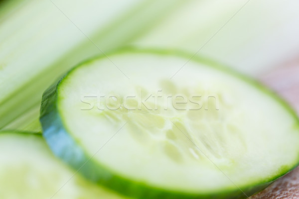 close up of cucumber slices and celery Stock photo © dolgachov