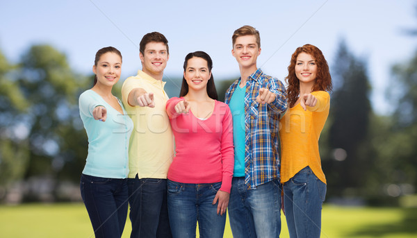group of smiling teenagers over green park Stock photo © dolgachov