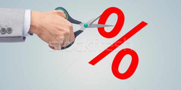 close up of businessman with scissors and percents Stock photo © dolgachov