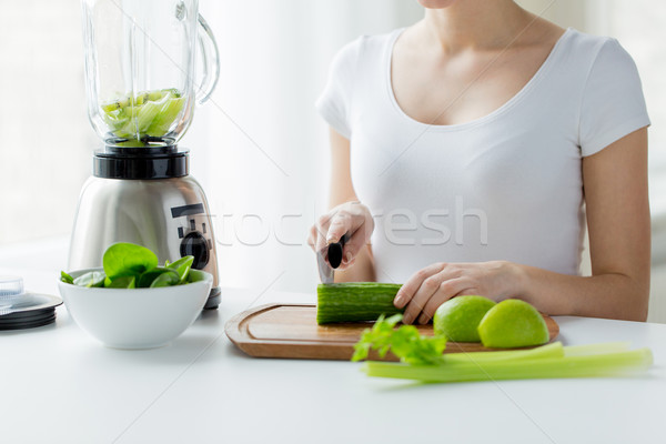close up of woman with blender chopping vegetables Stock photo © dolgachov