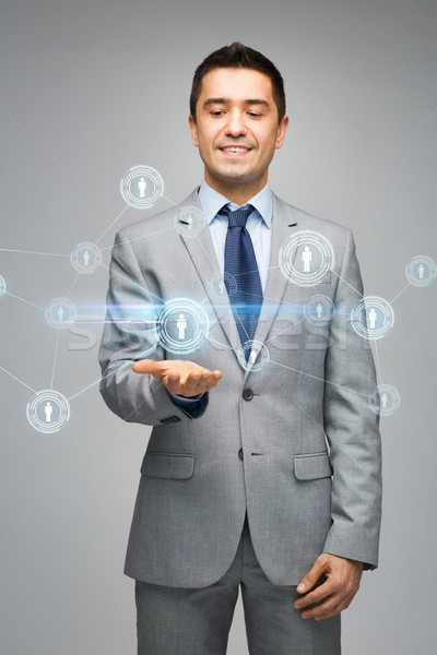 happy businessman in suit showing network contacts Stock photo © dolgachov