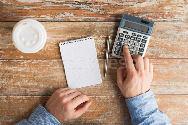 close up of hands with calculator and notebook Stock photo © dolgachov