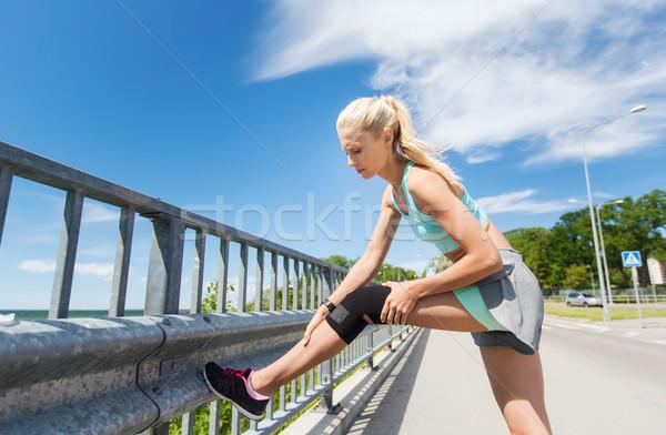 若い女性 膝 脚 屋外 フィットネス ストックフォト © dolgachov