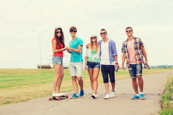 group of smiling teenagers with skateboards Stock photo © dolgachov