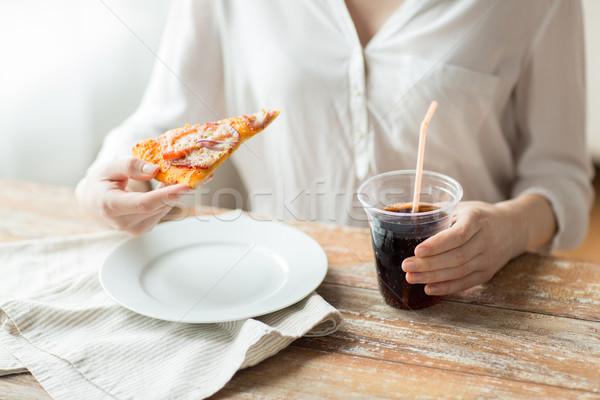 Közelkép nő pizza kóla ital gyorsételek Stock fotó © dolgachov