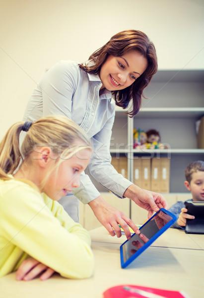 Stock fotó: Kislány · tanár · táblagép · iskola · oktatás · általános · iskola