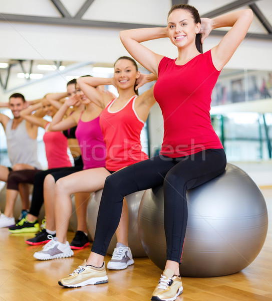 group of people working out in pilates class Stock photo © dolgachov