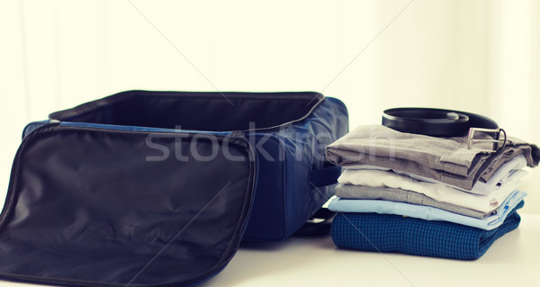 close up of business travel bag and clothes Stock photo © dolgachov