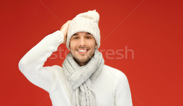 handsome man in warm sweater, hat and scarf Stock photo © dolgachov