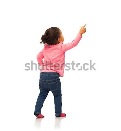 Afrikaanse wijzend vinger iets mensen Stockfoto © dolgachov