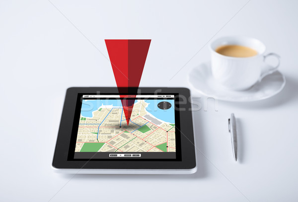 tablet pc with gps navigator map and cup of coffee Stock photo © dolgachov