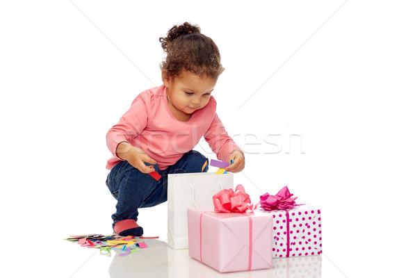 happy little baby girl with birthday presents Stock photo © dolgachov