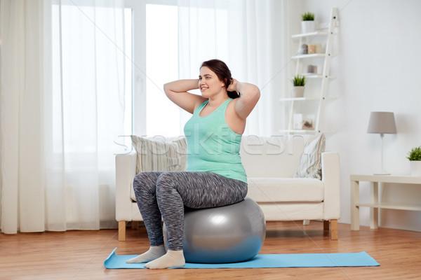 Artı boyutu kadın egzersiz uygunluk top spor Stok fotoğraf © dolgachov