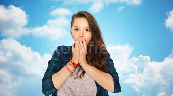 scared teenage girl over blue sky Stock photo © dolgachov
