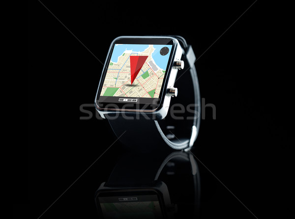 close up of smart watch with gps navigation app Stock photo © dolgachov
