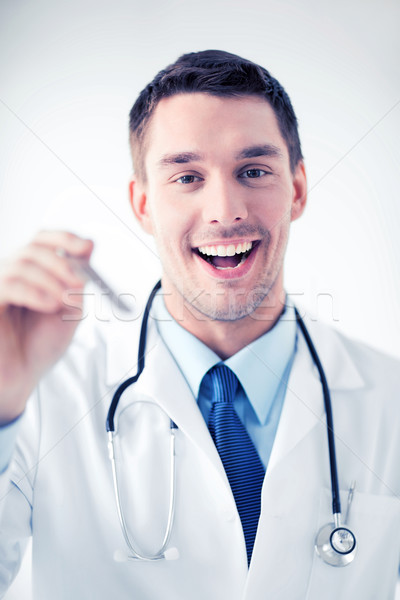 male ear nose throat doctor Stock photo © dolgachov