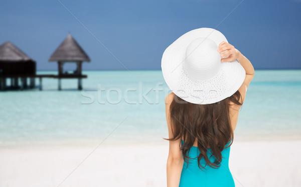 Mulher maiô de volta praia pessoas Foto stock © dolgachov