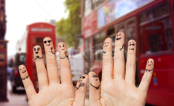 close up of fingers with smiley faces wedding Stock photo © dolgachov
