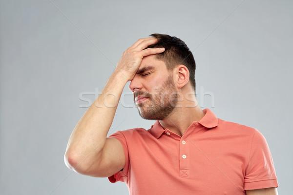 Mutsuz adam kafa ağrı insanlar Stok fotoğraf © dolgachov