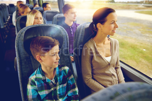 happy family riding in travel bus Stock photo © dolgachov