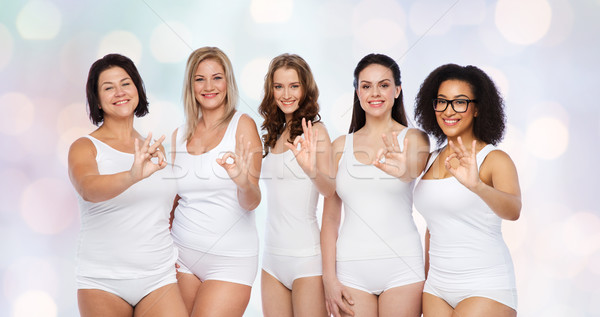 group of happy different women showing ok sign Stock photo © dolgachov